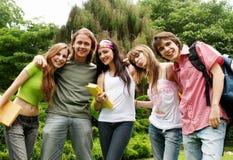 De gelukkige jonge studenten van het portret Stock Afbeeldingen