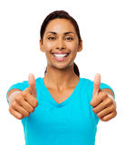 De gelukkige Jonge Vrouw Gesturing beduimelt omhoog Royalty-vrije Stock Foto's