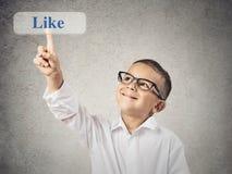 De gelukkige jongen klikt als knoop Royalty-vrije Stock Foto