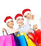 De gelukkige jongens van de Kerstman met giften Stock Fotografie