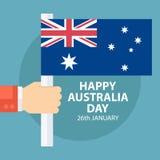 De gelukkige kaart van de de Daggroet van Australië met mannelijke hand die Australische vlag houden Stock Foto's