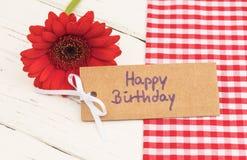 De gelukkige kaart van de Verjaardagsgroet met mooie rode bloem stock foto's