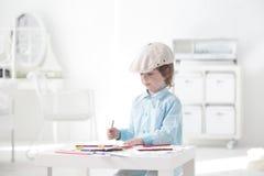 De kinderen schilderen royalty-vrije stock fotografie