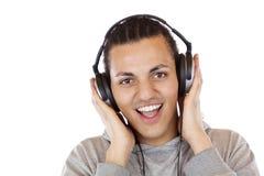 De gelukkige mens met hoofdtelefoons luistert aan mp3 muziek Royalty-vrije Stock Fotografie