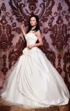 Mooie sexy bruid in witte huwelijkskleding Stock Foto's