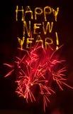 De gelukkige sterretjes van het Nieuwjaar met roze vuurwerk Royalty-vrije Stock Fotografie