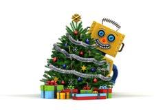 De gelukkige Stuk speelgoed robot met Kerstmisboom en stelt voor Royalty-vrije Stock Afbeeldingen
