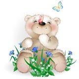 De gelukkige Teddybeer zit in een weide flowers1 Stock Afbeeldingen