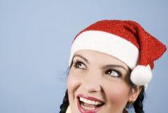 De gelukkige vrouw die van de Kerstman hogere linkerzijde kijkt Stock Foto