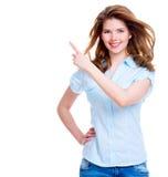 De gelukkige vrouw toont een vinger in de kant Stock Fotografie