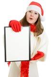 De gelukkige vrouw van Kerstmis met in hand tablet Stock Foto's