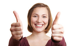 De gelukkige vrouwenholding beduimelt omhoog Stock Foto's