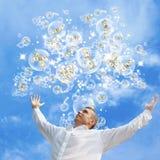 De gelukkige zakenman in roze dromen Stock Foto's