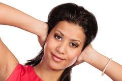 De gemengde sluitende oren van de rasvrouw met handen stock fotografie
