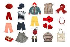 De geplaatste kleren en de toebehoren van jonge geitjes Royalty-vrije Stock Foto's