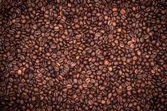 De geroosterde achtergrond van koffiebonen Stock Foto