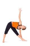 De geschikte Aantrekkelijke het Praktizeren van de Vrouw Yoga stelt stock afbeeldingen