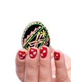 De geschilderde Hand van de paaseivrouw Stock Afbeelding