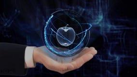 De geschilderde hand toont conceptenhologram 3d appel op zijn hand stock videobeelden