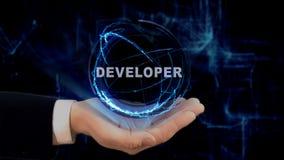 De geschilderde hand toont de Ontwikkelaar van het conceptenhologram op zijn hand royalty-vrije stock afbeelding