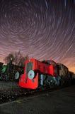 De geschilderde Trein van de stoom bij het opruimen licht Stock Fotografie