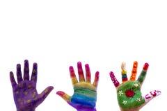 De geschilderde waterverf van het kind handen op witte achtergrond. Stock Foto
