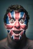 De geschokte mens met Britse vlag schilderde op gezicht Royalty-vrije Stock Fotografie