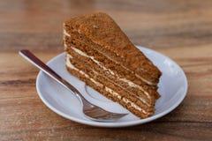 De gesneden Cake van de Honing Stock Afbeeldingen