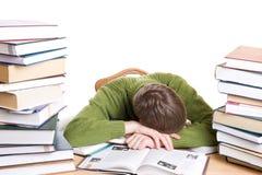 De geïsoleerde slaapstudent met boeken Stock Afbeelding