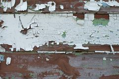 De geweven achtergrond van oude raad omvat met witte verf barstte van oude dag royalty-vrije stock afbeeldingen
