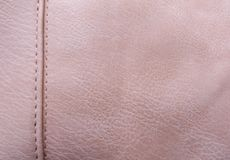 De geweven huid is roze in kleur De achtergrond van de close-upmening royalty-vrije stock foto's