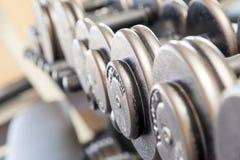 De gewichten van de het materiaaldomoor van de geschiktheidsoefening Stock Foto's