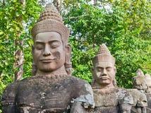 De gezichten van de steen op het Gebied van Angkor Wat Stock Afbeelding