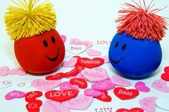 De Gezichten van Smiley van de valentijnskaart in Liefde stock afbeelding