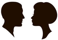 De gezichtenprofielen van de man en van de vrouw Stock Foto's