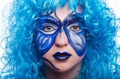 De gezichtsverf van vrouw met vlinder royalty-vrije stock afbeelding