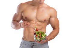 De gezonde etende bouwer van het de bodybuilderlichaam van de voedselsalade bodybuilding royalty-vrije stock foto