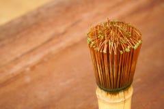 De gezonde groene thee in kop en het bamboe zwaaien Stock Afbeeldingen