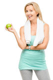 De gezonde rijpe groene die appel van de vrouwenoefening op witte rug wordt geïsoleerd Stock Foto's