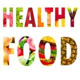 De gezonde tekst van het voedselwoord in hoofdletters op wit Stock Afbeeldingen