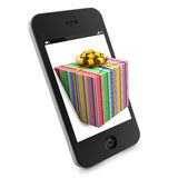 De gift die van Kerstmis uit smartphone komt Stock Foto