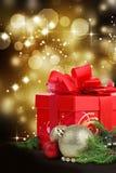 De gift van Kerstmis met abstracte achtergrond Royalty-vrije Stock Afbeeldingen