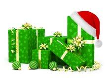 De giften van Kerstmis en santahoed Stock Afbeelding