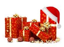 De giften van Kerstmis en santahoed Stock Afbeeldingen