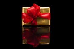 De giften van Kerstmis, op zwarte Royalty-vrije Stock Foto's