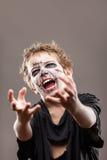 De gillende lopende dode jongen van het zombiekind Royalty-vrije Stock Afbeelding