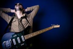 De gitaarspeler van de rots stock foto's