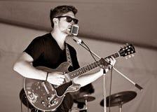 De gitarist Kyler Tapscott presteert bij Cultivate Voedselfestival - 27 September, 2015 in Havenhoop Stock Afbeelding