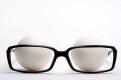 De glazen en de eieren van de lezing Stock Afbeelding