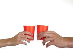 De glazen en de handen van het document Stock Fotografie